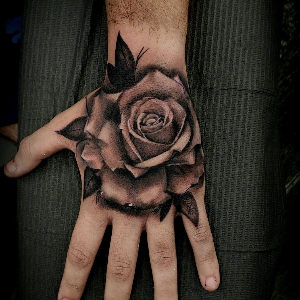 Choosing Your Perfect Rose Hands Tattoo Design