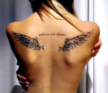 Fancy Tattoo Design Ideas for a Wings Tattoo on Back