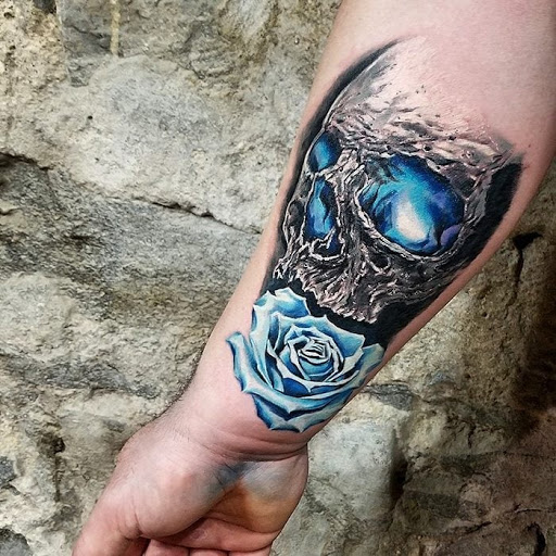 Choose The Beautiful Skull And Rose Tattoo