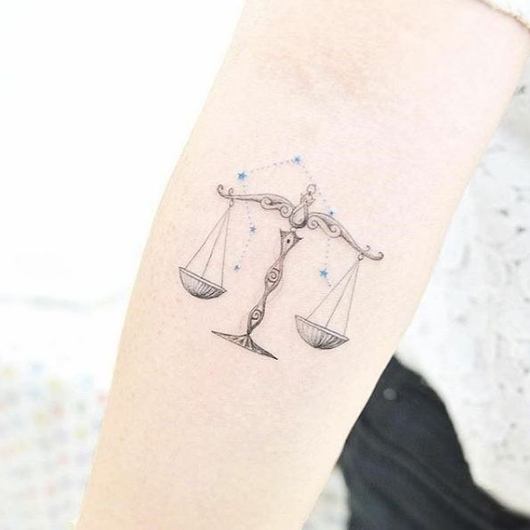 Scales of Justice Tattoo Are Trendy Now